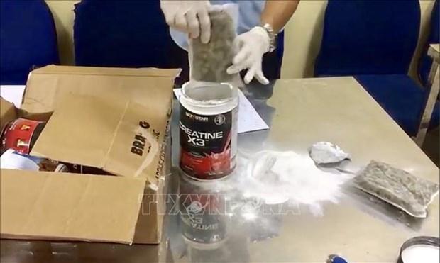 新山一国际机场口岸海关分局成功破获一起从美国运往越南毒品案 hinh anh 1