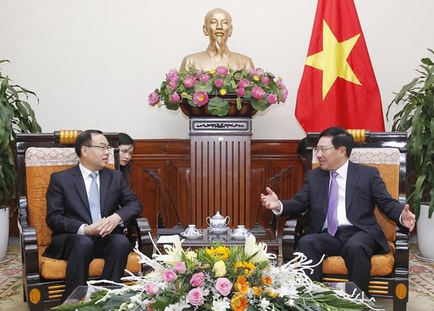 越南政府副总理兼外长范平明会见中国重庆市长唐良智 hinh anh 1
