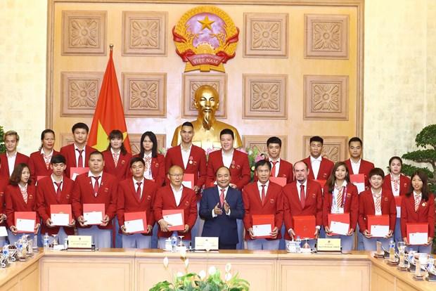 阮春福总理亲切会见参加第18届亚运会的越南体育代表团 hinh anh 1