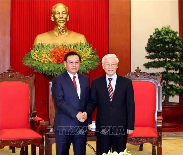 阮富仲会见老挝建国阵线中央委员会代表团 hinh anh 1
