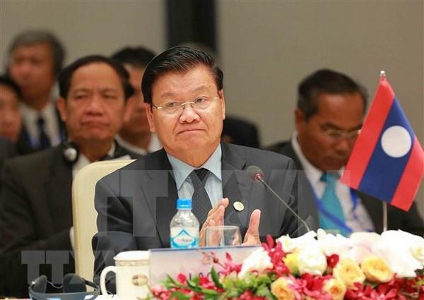 老挝政府总理通伦将赴越出席2018年世界经济论坛东盟峰会 hinh anh 1