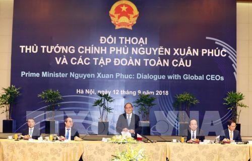 WEF ASEAN 2018:政府总理阮春福与全球各家集团领导进行对话 hinh anh 1