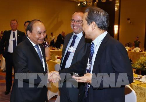 WEF ASEAN 2018:政府总理阮春福与全球各家集团领导进行对话 hinh anh 2