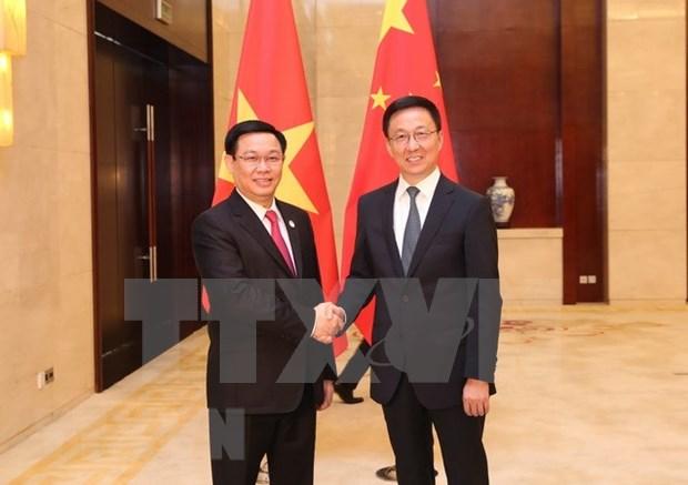 越南政府副总理王廷惠与中国国务院副总理韩正举行会谈 hinh anh 1