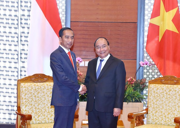 WEF ASEAN 2018:阮春福总理会见印尼总统佐科·维多多 hinh anh 1