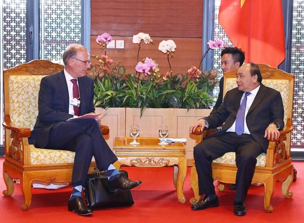 WEF ASEAN 2018:政府总理阮春福会见嘉士伯首席执行官郝瀚思 hinh anh 1