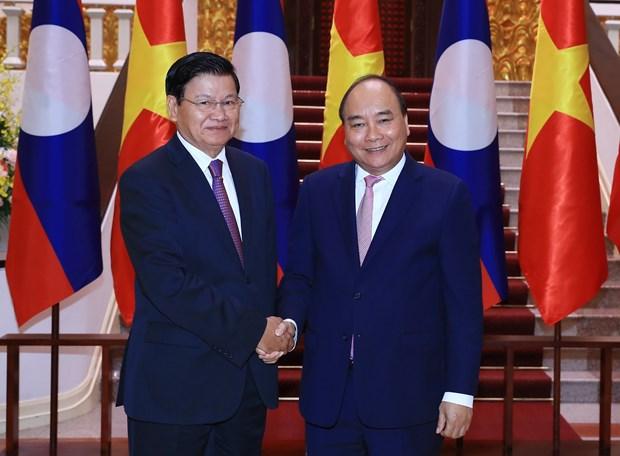 WEF ASEAN 2018: 政府总理阮春福会见老挝总理通伦·西苏里 hinh anh 1
