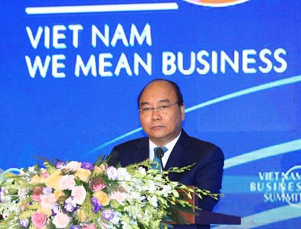 WEF ASEAN 2018:政府总理阮春福和WEF主席共同主持2018年越南工商峰会上的对话 hinh anh 2