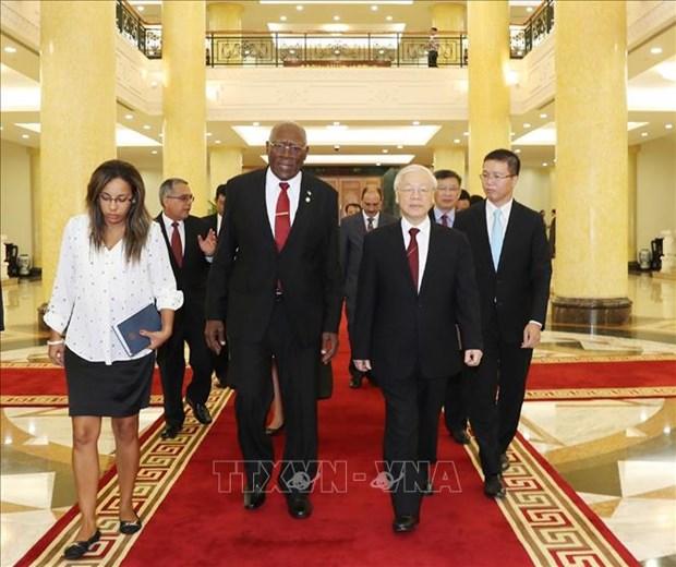 越共中央总书记阮富仲会见古巴党和国家领导 hinh anh 1