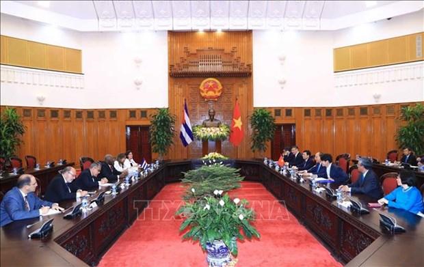 越南政府总理阮春福会见古巴共和国国务委员会第一副主席兼第一副部长会议 hinh anh 2