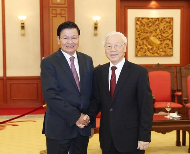 越共中央总书记阮富仲会见老挝总理通伦 hinh anh 1