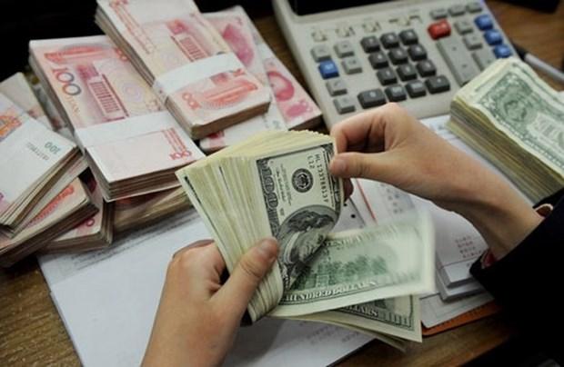 14日越盾兑美元汇率下降 人民币和英镑汇率略增 hinh anh 1
