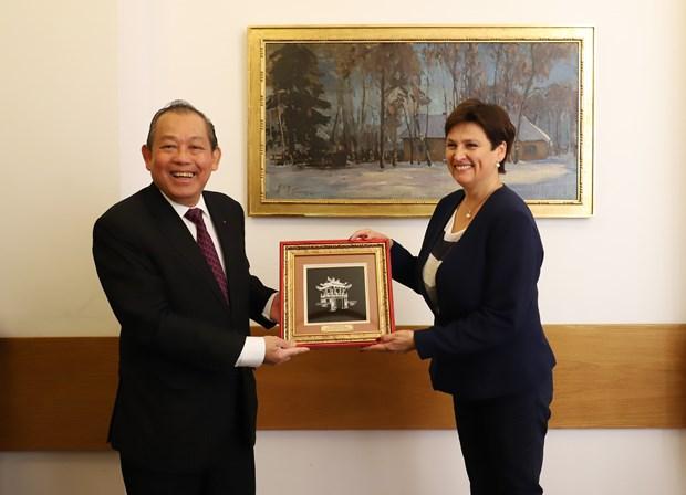 越南政府常务副总理张和平对波兰进行正式访问 hinh anh 3