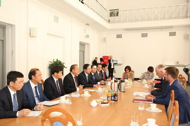 越南政府常务副总理张和平对波兰进行正式访问 hinh anh 4