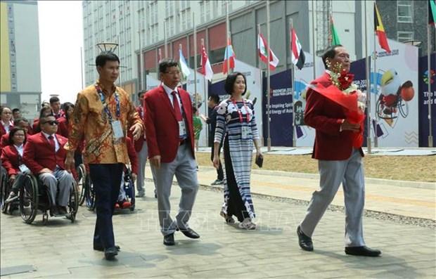 2018年第三届亚残会:越南体育代表团在雅加达举行升旗仪式 hinh anh 2