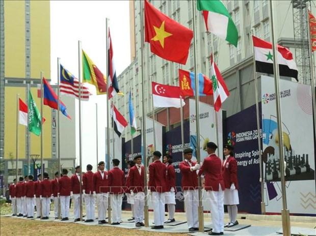 2018年第三届亚残会:越南体育代表团在雅加达举行升旗仪式 hinh anh 1