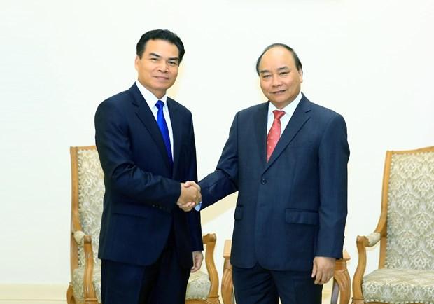 越南政府总理阮春福会见老挝总理府部长兼办公厅主任佩·蓬皮帕 hinh anh 1