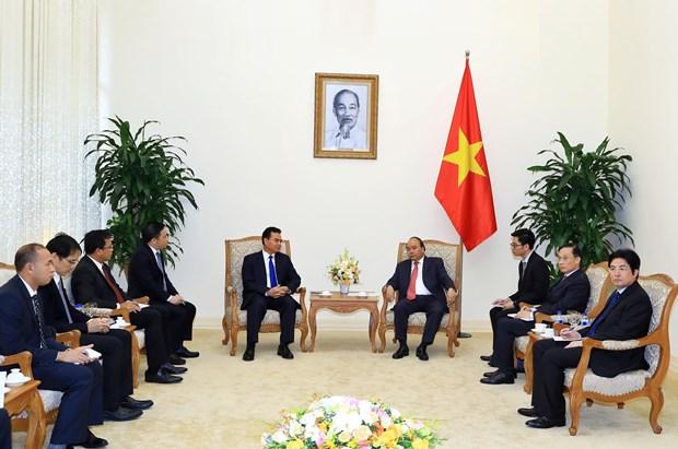 越南政府总理阮春福会见老挝总理府部长兼办公厅主任佩·蓬皮帕 hinh anh 2