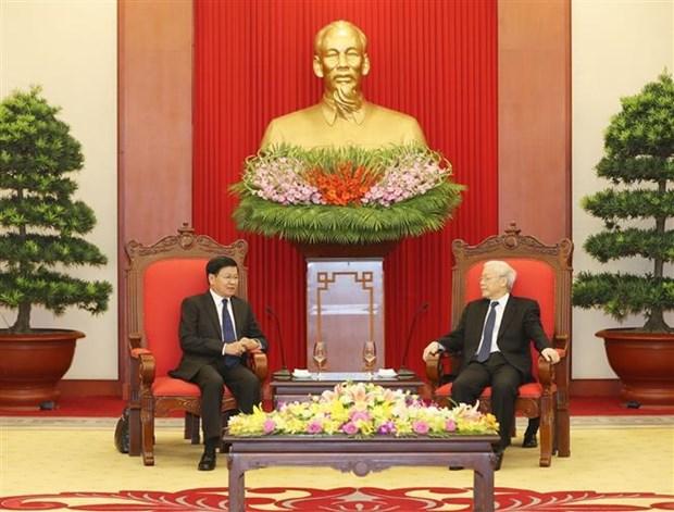 越共中央总书记阮富仲会见老挝政府总理通伦•西苏里 hinh anh 1