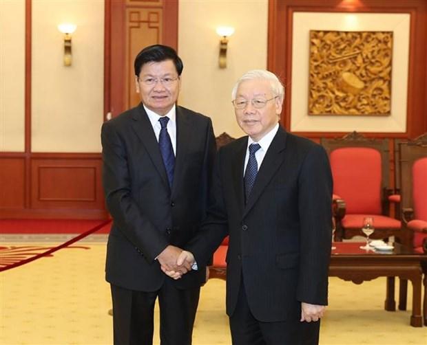 越共中央总书记阮富仲会见老挝政府总理通伦•西苏里 hinh anh 2