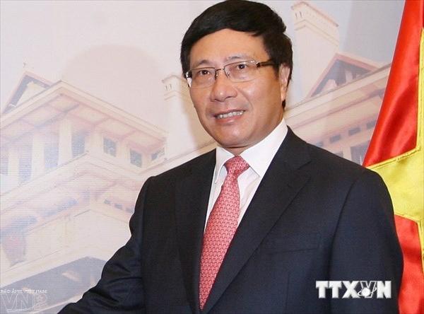 越南政府副总理兼外交部长范平明对英国进行正式访问 hinh anh 1