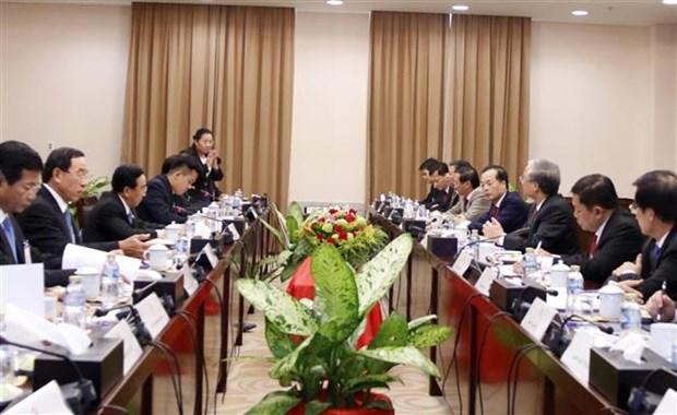 老挝人民革命党中央委员会总书记、老挝国家主席会见越共代表团 hinh anh 2