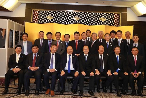 越南政府总理阮春福与日本企业举行座谈会 hinh anh 1