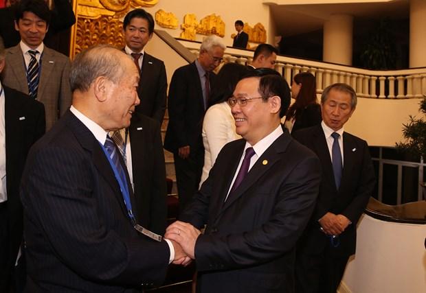 越南政府副总理王廷惠接见日本人民外交促进会代表团 hinh anh 1
