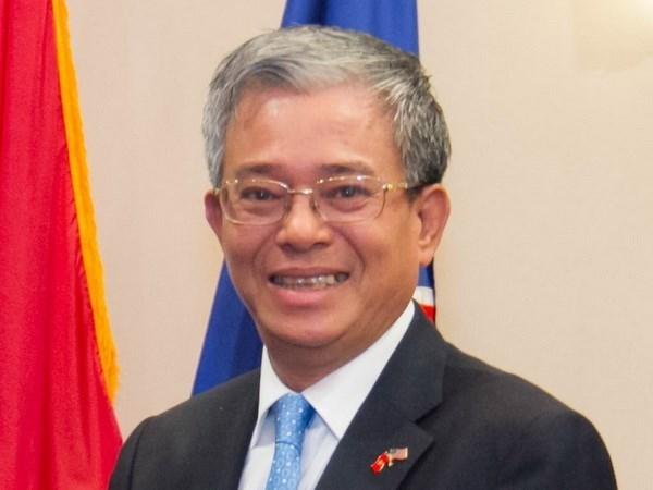 越南外交部副部长范光荣会见俄罗斯国际合作署署长 hinh anh 1