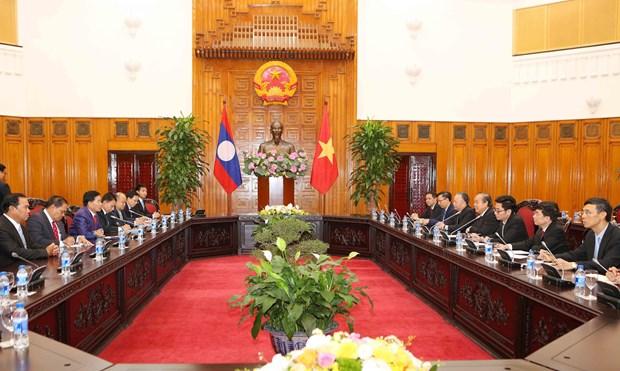 越南政府常务副总理张和平会见万象市委书记兼市长辛拉冯·库派吞 hinh anh 2
