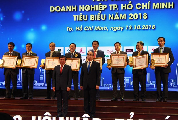 阮善仁:2018年优秀企业和企业家是胡志明市经济发展事业的领跑者 hinh anh 1