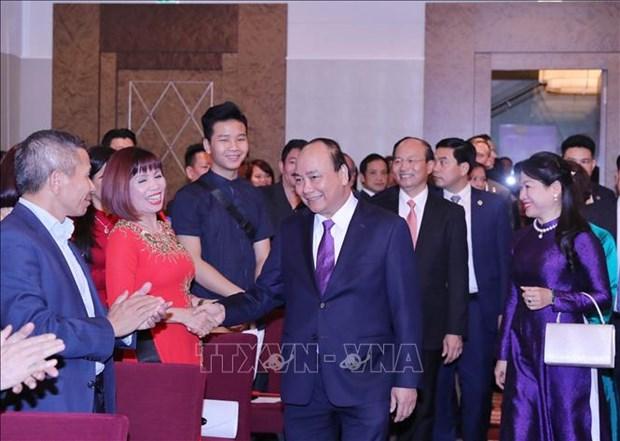 越南政府总理阮春福会见旅居奥地利越南人代表 hinh anh 1