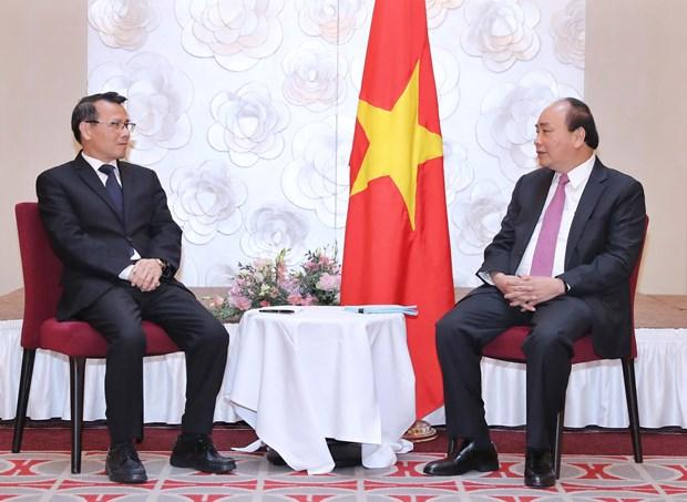 政府总理阮春福会见旅居欧洲越南人协会联合会代表 hinh anh 2