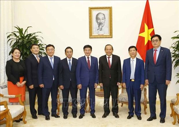 张和平会见蒙古国法律和内务部长尼亚木道尔吉 hinh anh 2