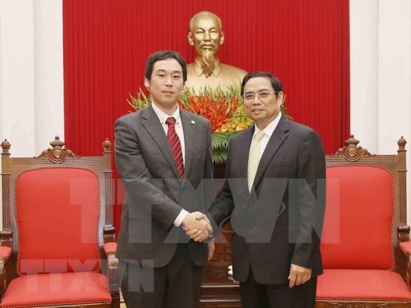 越共中央组织部部长范明正会见日本共产党代表团 hinh anh 1