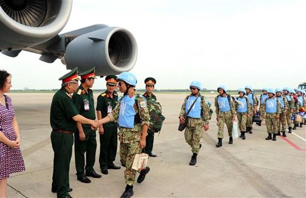 越南参与联合国维和行动:为创建和平世界贡献力量 hinh anh 1