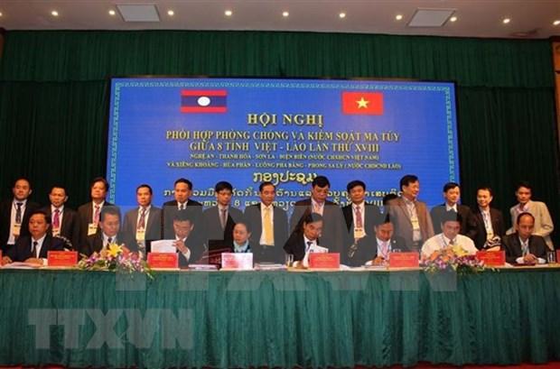 越南与老挝加强合作打击各类毒品犯罪活动 hinh anh 1
