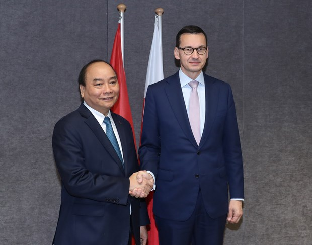 政府总理阮春福出席第十二届亚欧首脑会议期间举行多场双边会晤 hinh anh 3
