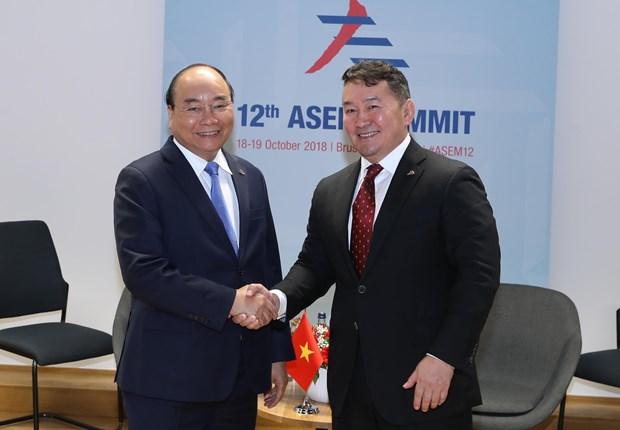政府总理阮春福出席第十二届亚欧首脑会议期间举行多场双边会晤 hinh anh 1