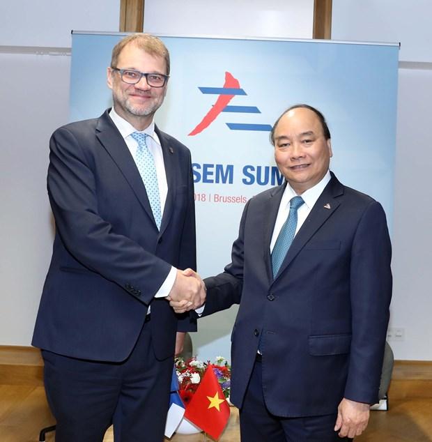 政府总理阮春福出席第十二届亚欧首脑会议期间举行多场双边会晤 hinh anh 4