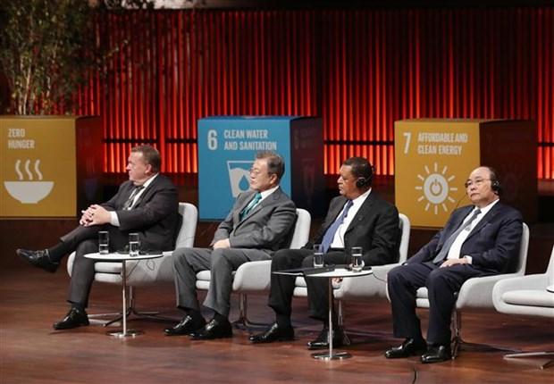 政府总理阮春福出席全球绿色目标伙伴2030峰会 hinh anh 1