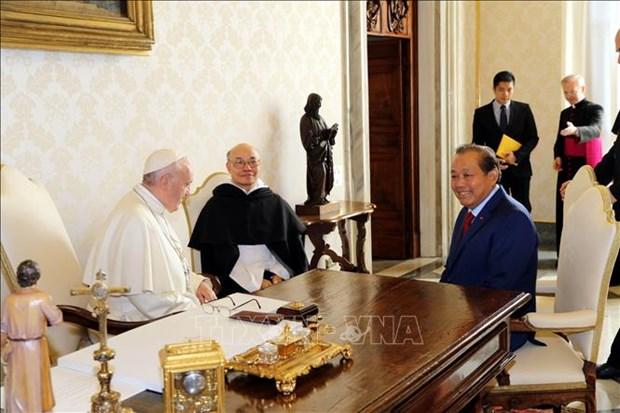 越南政府常务副总理张和平访问梵蒂冈 hinh anh 1