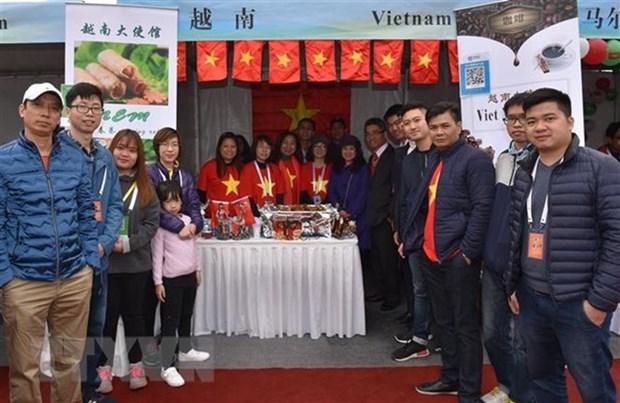 越南参加在中国举行的国际义卖活动 hinh anh 2