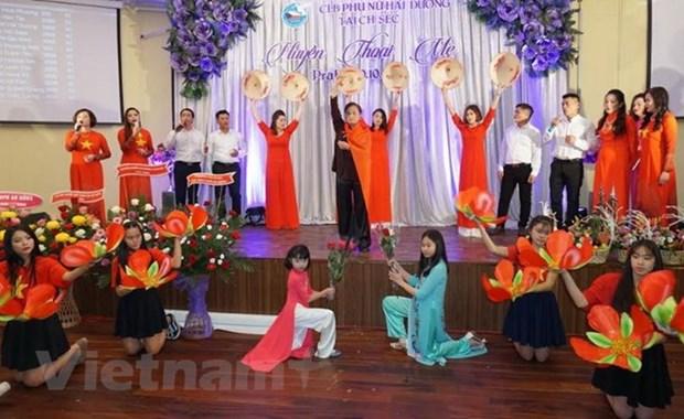海外越南人举行活动庆祝越南妇女节 hinh anh 1
