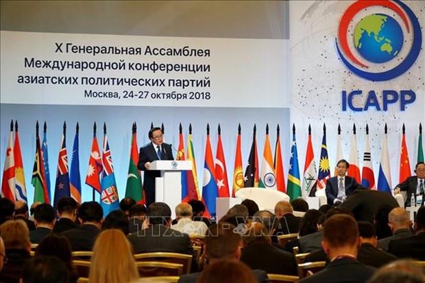 越南共产党代表团出席亚洲政党国际会议第十届大会 hinh anh 1