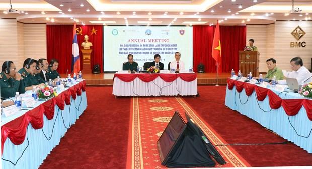 越南与老挝加强林业执法领域的合作 hinh anh 1
