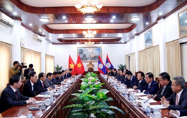 越共中央检查委员会与老挝人民革命党中央纪检委员会加强合作 hinh anh 1