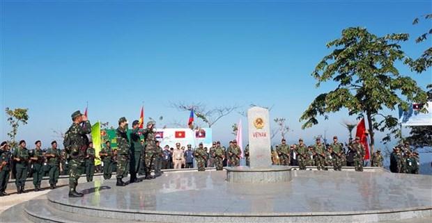 越老柬三国举行向界碑敬礼和边境联合巡逻见证仪式 hinh anh 1