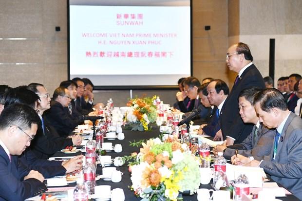 阮春福与中国各家一流集团领导举行座谈 hinh anh 1
