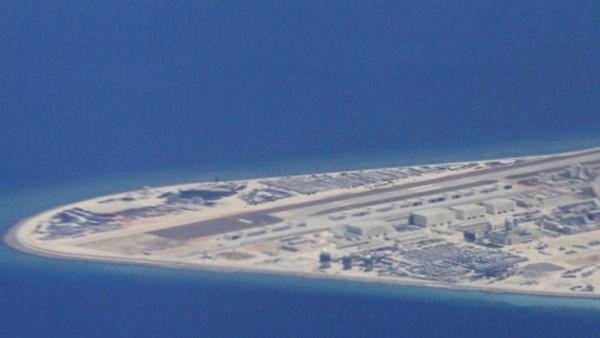 中国将在越南长沙群岛上所设的若干观测站投入使用严重侵犯越南主权 hinh anh 1